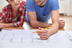 Couple syudying home plans