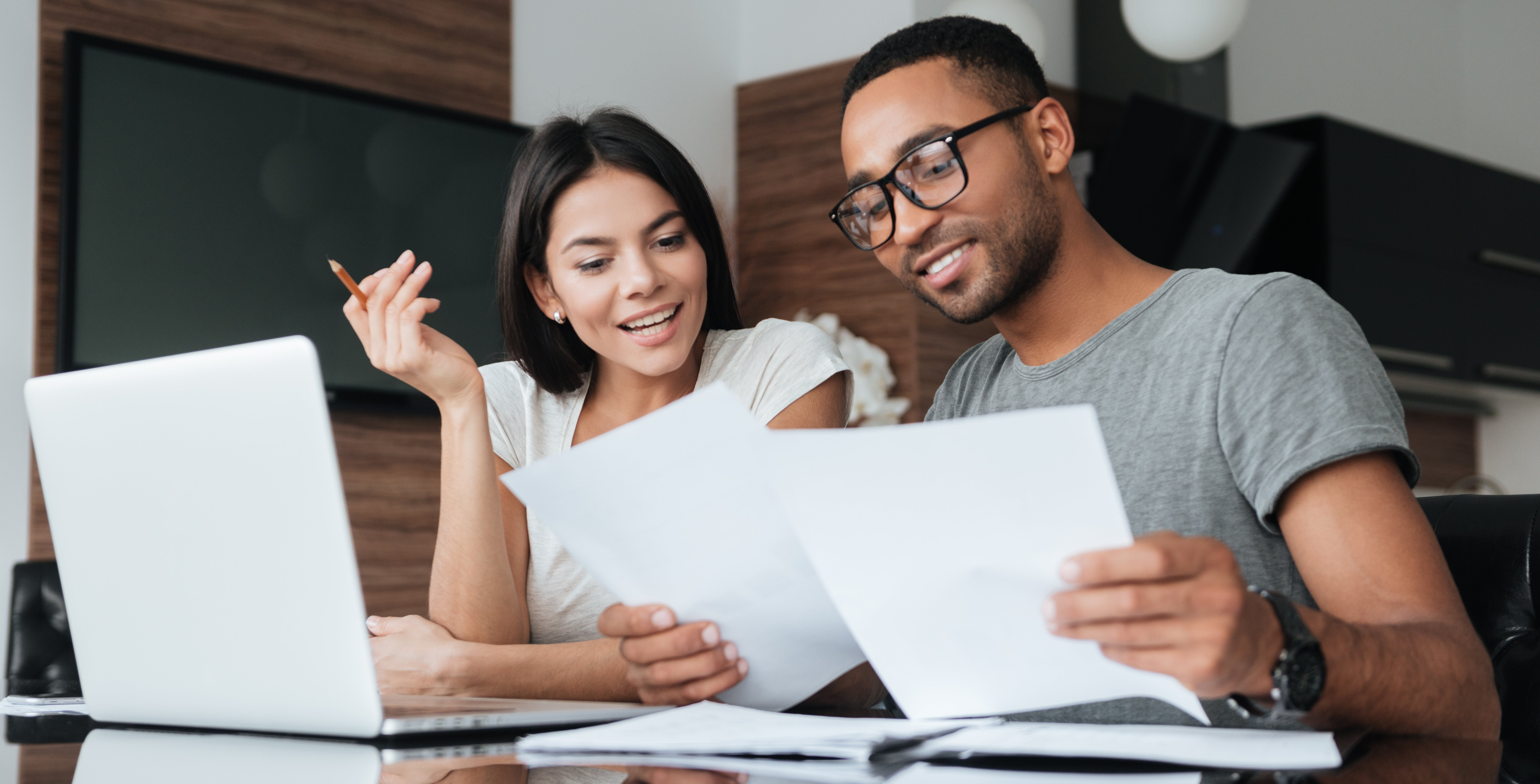 Couple looking at impact window financing