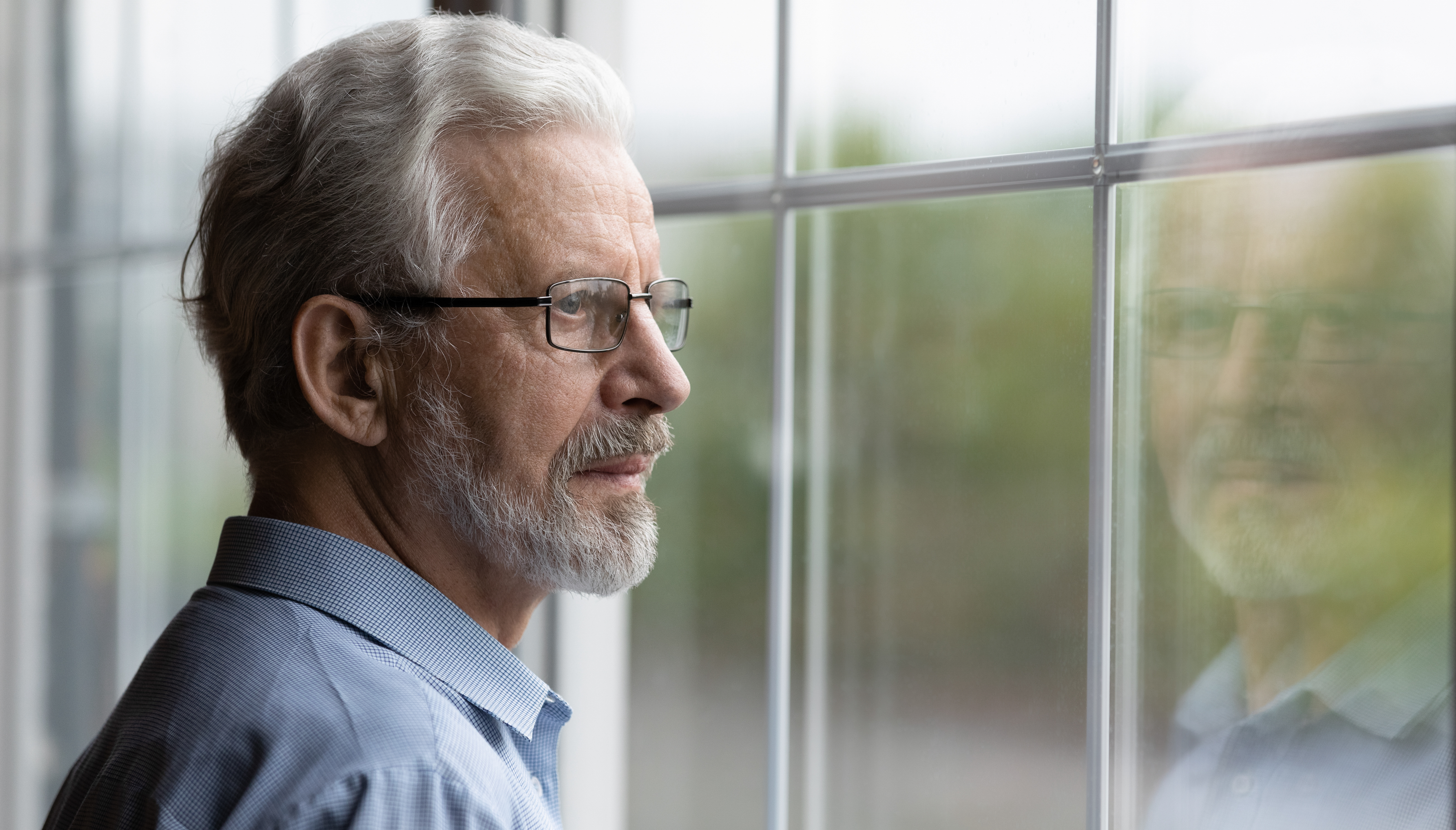 Man looking out miami window