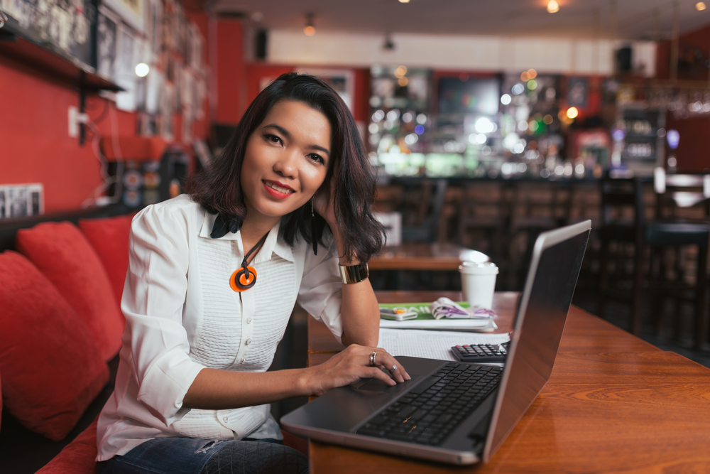 restaurant owner on computer