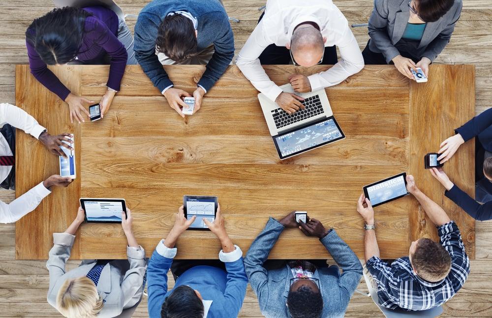 Office Staff Using Tech